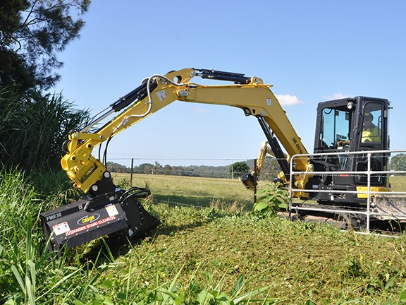 A Digga flail mower attached to a light excavator.