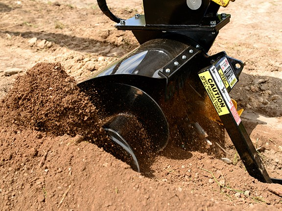The Digga Bigfoot trencher's barrel and spoil auger for discharging trench spoil is a great innovation.