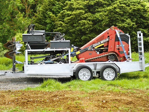 One trailer is all that was needed for the SK755 loader and its attachments.