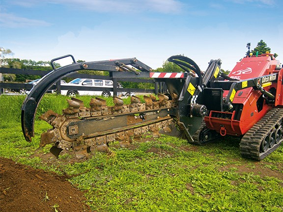 Using the trencher was made easy by using the mini skid steer loader's foot-operated continuous flow option.