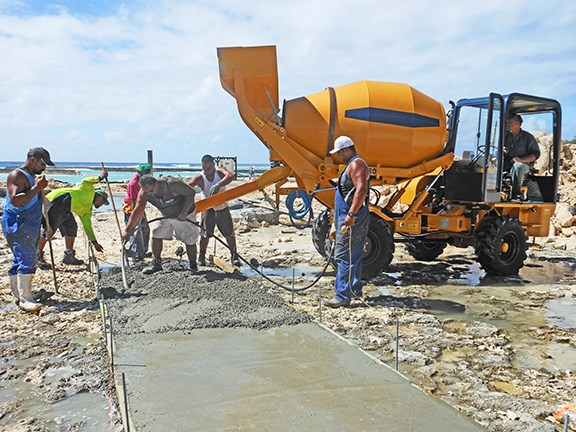 The Fiori DB 180 self-loading concrete mixer at work on the island of Manihiki, Cook Islands.
