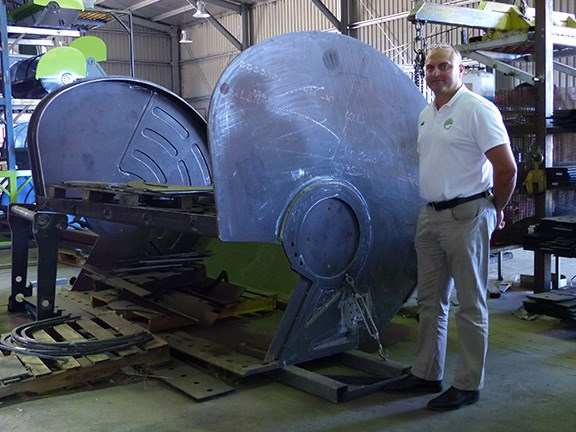 David Barkla with the 45-tonne excavator model on the assembly line