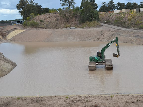 The Heking HK150SD excavator looking more at home in the completed sediment basin.