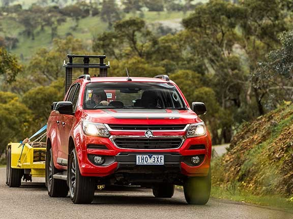 Holden Colorado towing excavator uphill