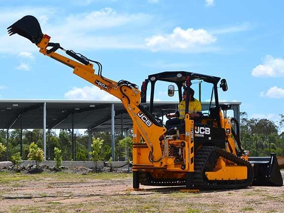 JCB 1CXT backhoe loader with dipping arm extended
