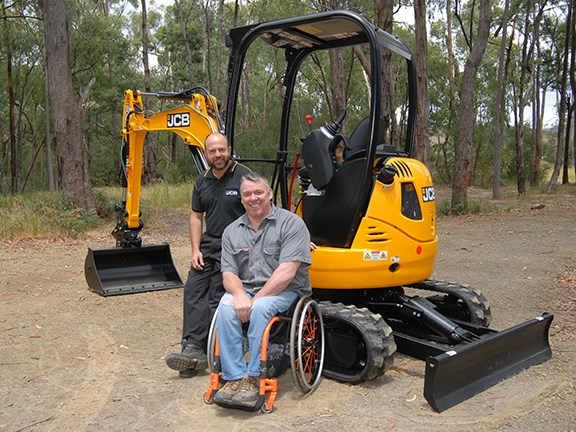JCB's Brendan Clarke and safety speaker James Wood with the modified 8025 ZTS mini excavator.