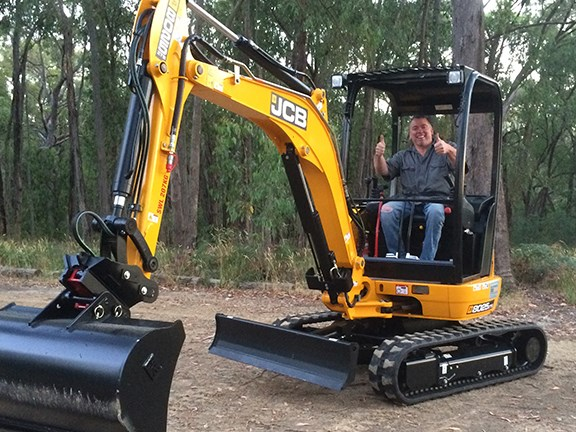 Paraplegic James Wood says he's really impressed with the modified JCB 8025 ZTS excavator.