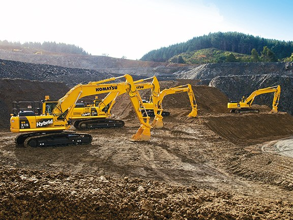 A lineup of talented Komatsu earthmovers, including the HB215LC-1 and HB335LC hybrids.