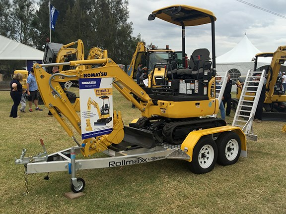 Komatsu was showing off a tradie deal on its PC18MR-3 mini excavator — digger, KGA half hitch, 300mm KGA bucket and 2.4-tonne Sureweld trailer from $25 a day.