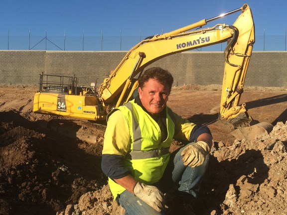 Reviewer Ron Horner with the Komatsu PC300LC-8 excavator.