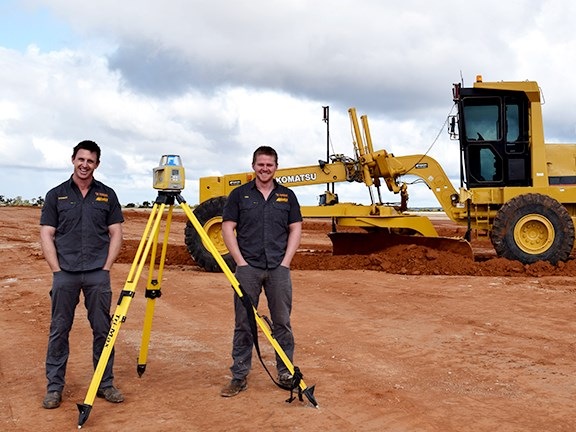 Morgan Earthmoving brothers Stewart (left) and Ashley Morgan with the Topcon System 5 automatic 2D machine control system. Stewart started the company with their brother Rob 16 years ago.