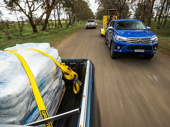 Fully loaded Toyota Hilux ute travelling at speed