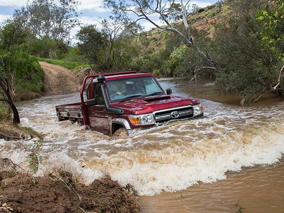 Toyota Landcruiser 70 series traversing a river