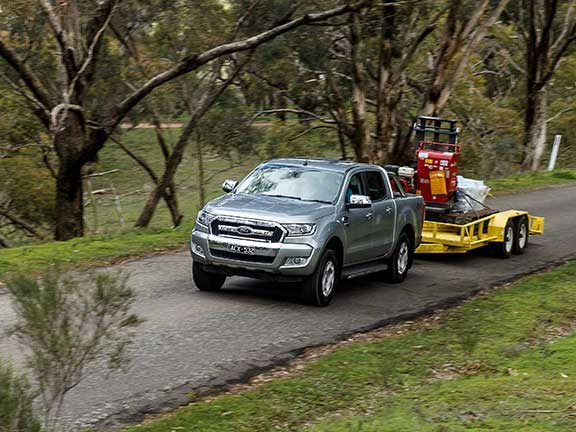 Ford Ranger ute towing excavator