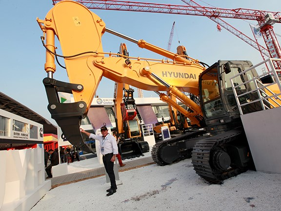 Bauma China 2014: Ron Horner checks out a newly designed ripper and rock dipper arm from Hyundai.