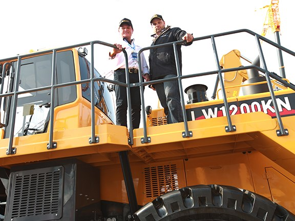 Bauma China 2014: Ron Horner and Ranger CE's Bernard Shapland on the XCMG 1200 loader.