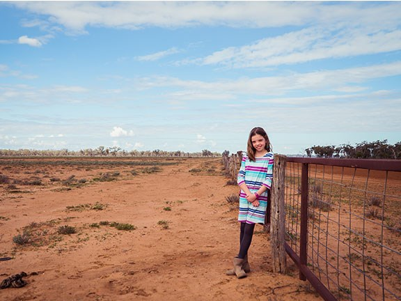 Girl in drought-affected Queensland paddock