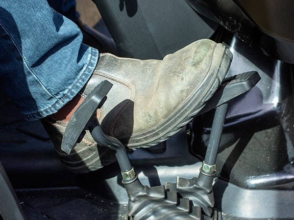 Boot on tractor pedal