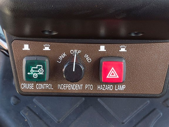 The Branson 6225Ch's cruise control and three-point-linkage PTO operation button