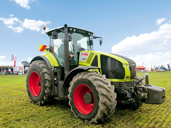 The Claas Axion 930 front on