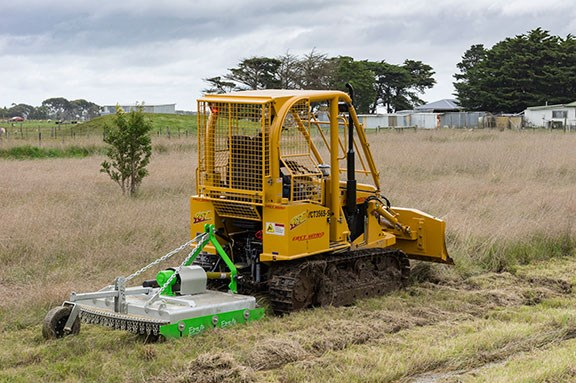 The East Wind compact dozer towing a 1.2m slasher