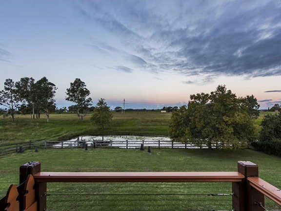 The stunning green paddocks from the deck