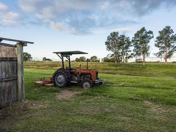 The vintage tractor comes with the property