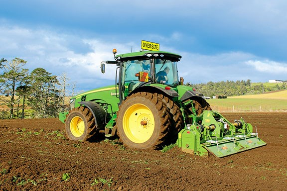 The John Deere 8235R with the 4m rotary hoe behind