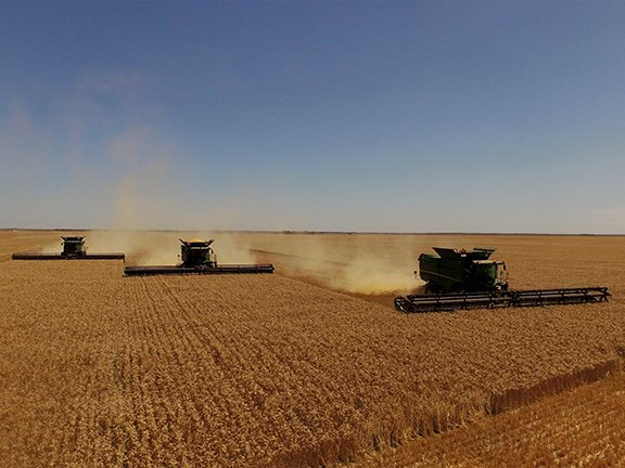 Three 60ft Midwest Durus harvest draper platforms cutting a massive 180ft of wheat in one pass, in Western Australia.