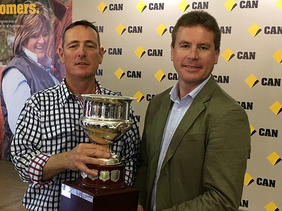 Agronomist Greg Rummery (left) receives the prestigious Brownhill Cup from Commonwealth Bank regional and agribusiness banking general manager Tim Harvey.