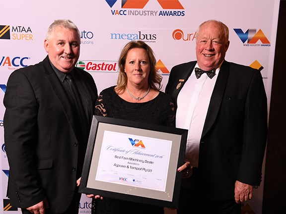 Agpower & Transport representatives Brendan and Loretta O'Donnell (left and centre) accept the award from VACC president Peter Savige.