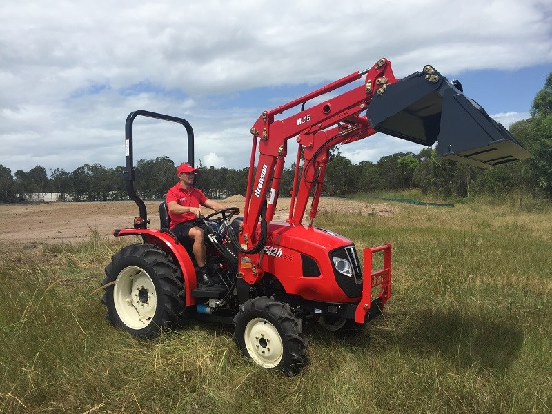 Branson F42H tractor with loader in action