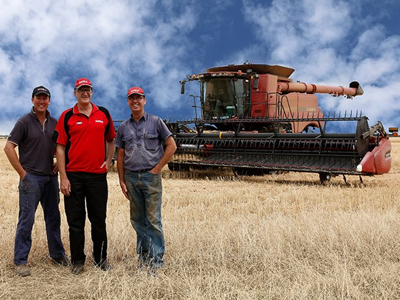 WA farmers Gary and Shaun Shadbolt (left and right) with Hutton and Northey Sales Mukinbudi branch manager Ian Clune. The Shadbolts are pleased with their latest acquisition, the Case IH Axial-Flow 7240 combine harvester.