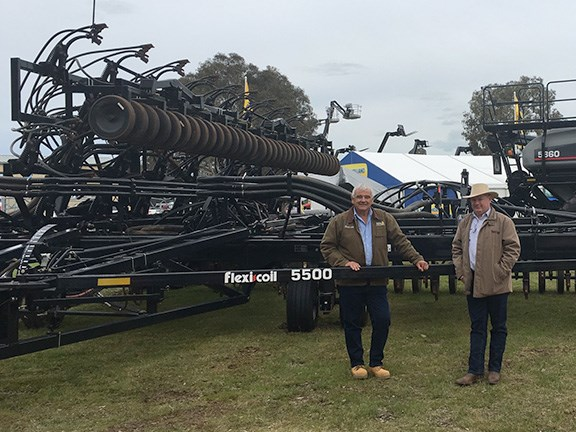 Flexi-Coil NSW and QLD territory manager Phil Avery (left) and brand leader Steve Mulder unveil the Flexi-Coil 5500 for the very first time at HMFD 2016. The 24.4m air seeder features adaptable row spacings and the option of either rubber or steel packing systems. At the rear is the Flexi-Coil 5860 Air Cart, a 20,000-litre unit which won best new release at this year's Dowerin Field days in Western Australia.