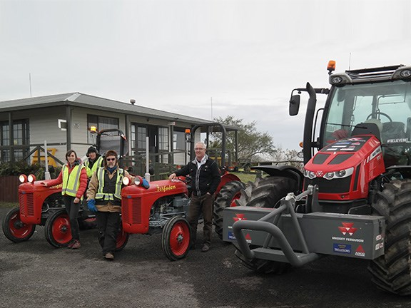 The Expedition South team with the line-up of tractors that will be driven from Piha to Mt Cook. From the back, expedition leader Al Fastier, AHT Communications Administrator Lydia McLean, tractor driver Brian Blyth and Massey Ferguson New Zealand manager Peter Scott.