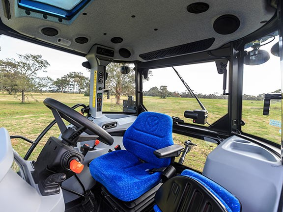 The driver is comfortable and has good visibility while working in the New Holland TD5.90 tractor.