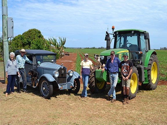 Margaret, Bob, Nicole, David and Chris Strathdee on the farm alongside their Buick and John Deere tractor.