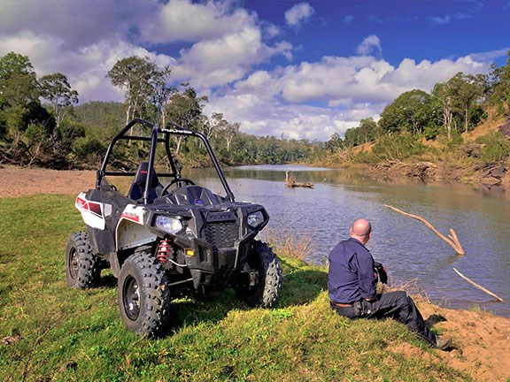 Polaris's ACE has a rollbar, seatbelts and a steering wheel, and makes an excellent farm vehicle if you need to cover long distances with some expectation of comfort