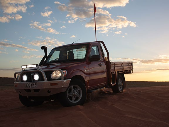 Mahindra pik up ute in desert sunset