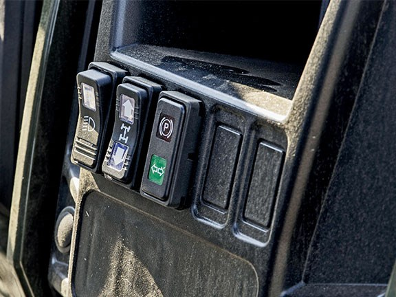 Push-switches replace rocker switches for transmission control