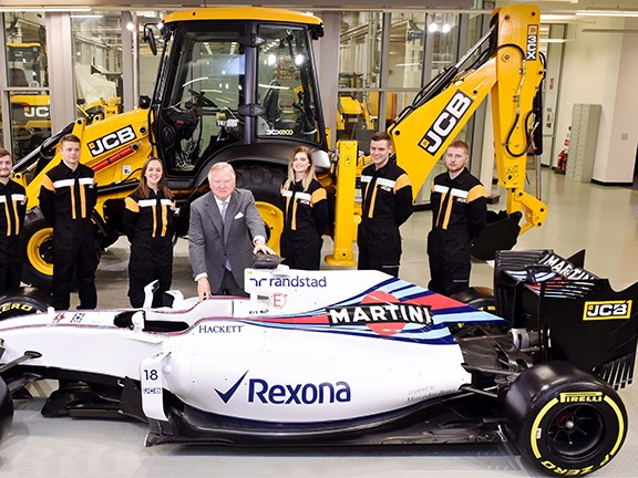 Lord Bamford, some of his team, and the Williams Martini F1 car