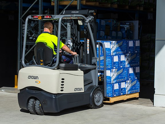 A Crown SC 4500 Series three-wheel, counterbalanced forklift in use at a Hunter Pacific International facility.