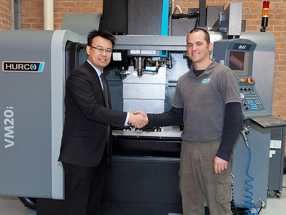Hurco SE Asia general manager Lee Wai Yip (left) and Custom Plenum Creations' Ariel Banco.