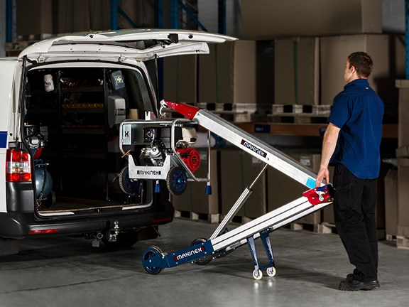The Makinex powered hand truck allows a single person to load heavy equipment