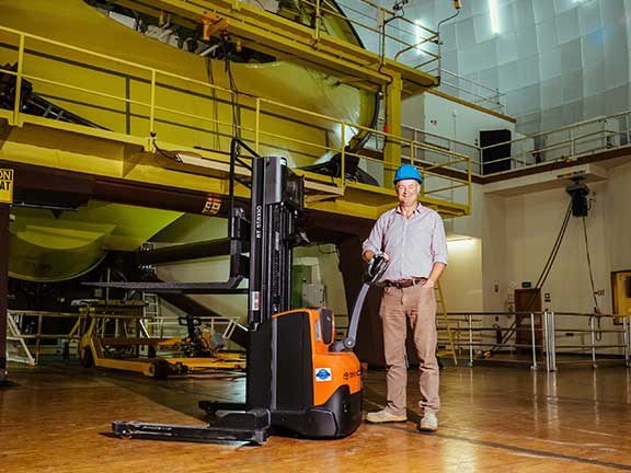 AAO manager Doug Gray posing with Toyota BT SWE120S walkie stacker forklift