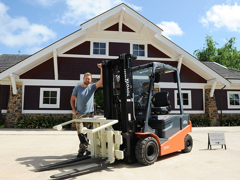 Ocean Eight Winery general manager and winemaker Mike Aylward with his new Toyota 8FBN25 8-Series battery-electric forklift.