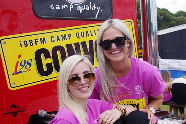 Lead truck bidder Allan Doherty may have been camera shy, but not so his granddaughters Kate (left) and Chloe Bradley.
