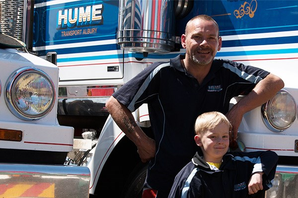 Andrew Iezzi and his son Xavier, seven, with the Western Star Andrew drives for Hume Transport.