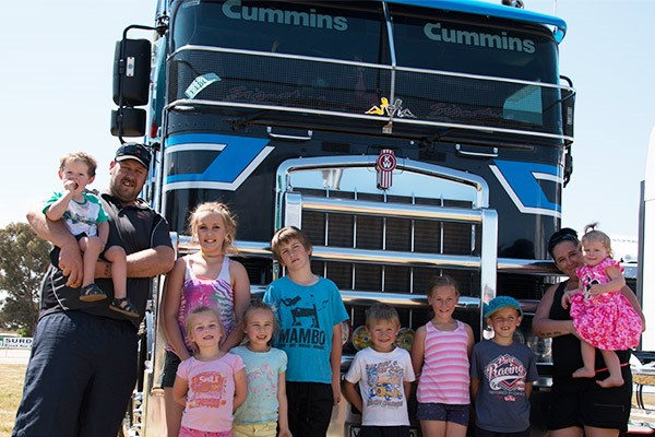 Enjoying the family day are James and Bianca Stewart of Albury with eight of their nine children and a nephew. James drives this 2008 Kenworth K108 for Queensland-based KJETS.