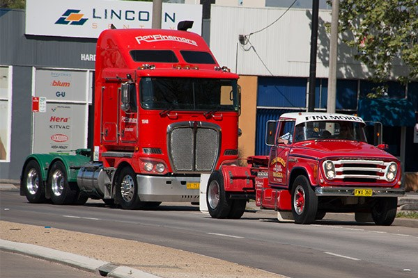 An old Finemores Haulage International with a new Ron Finemore Transport Kenworth.